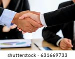 Small photo of Two confident business man shaking hands during a meeting, success, dealing, greeting and partner concept.Photo of two businessman handshaking .Successful deal after great meeting.