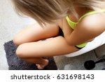 woman heaving belly ache | Shutterstock . vector #631698143