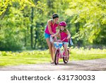 child riding bike. kid on... | Shutterstock . vector #631730033