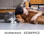 girls sleep with cats and dogs | Shutterstock . vector #631869413