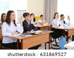 pupils raising hands to answer... | Shutterstock . vector #631869527