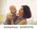 laughing woman and child at home   Shutterstock . vector #631876793