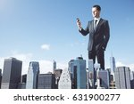 huge young businessman uisng... | Shutterstock . vector #631900277