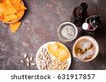 beer in bottles and glasses... | Shutterstock . vector #631917857