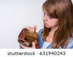 Small photo of Business woman holding an empty wallet, she hasn't money