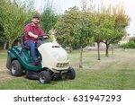 gardener cutting the grass of a ... | Shutterstock . vector #631947293