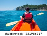 boy in life jacket on orange... | Shutterstock . vector #631986317