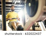 determined bodybuilder rowing. | Shutterstock . vector #632022437