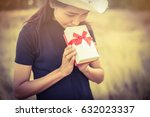 woman holding a gift box | Shutterstock . vector #632023337