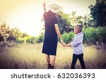mother with her little son   | Shutterstock . vector #632036393