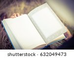 the book is on a meadow  | Shutterstock . vector #632049473