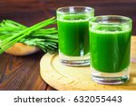 wheatgrass shot. juice from... | Shutterstock . vector #632055443