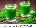 wheatgrass shot. juice from...   Shutterstock . vector #632055647