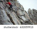 the climber climbs the rock...   Shutterstock . vector #632059913