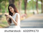 thai asian woman using earphone ... | Shutterstock . vector #632094173
