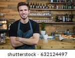 portrait of smiling waiter... | Shutterstock . vector #632124497