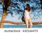 woman sitting on a fence with... | Shutterstock . vector #632166473