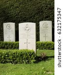 Small photo of COPENHAGEN, DENMARK - MAY, 2, 2017: 2 Royal British Seamen and an aircraftman on a Danish Bispebjerg cemetery. Copenhagen.
