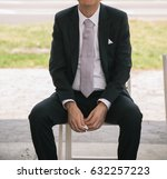 groom sitting on chair on... | Shutterstock . vector #632257223