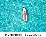 attractive woman in bikini is... | Shutterstock . vector #632260973
