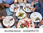 friends enjoying eating lunch... | Shutterstock . vector #632609273