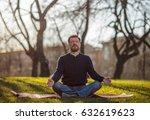 mature man sitting on yoga mat... | Shutterstock . vector #632619623