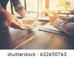 waiter serving hot fresh coffee ... | Shutterstock . vector #632650763