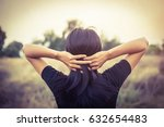 the girl stands on the meadow... | Shutterstock . vector #632654483