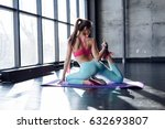 yoga mat woman stretching hip