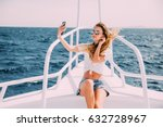 young girl sitting on the yacht ... | Shutterstock . vector #632728967