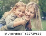 mother and daughter playing in... | Shutterstock . vector #632729693