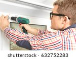 young man installing window... | Shutterstock . vector #632752283