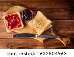 toast with cherry jam on rustic ...   Shutterstock . vector #632804963