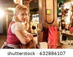 Small photo of Cheerful young woman working at alehouse