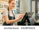 cheerful shop assistant using... | Shutterstock . vector #632895623