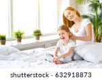 cute mother combing hair... | Shutterstock . vector #632918873