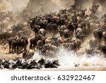 wildebeests mara river crossing | Shutterstock . vector #632922467