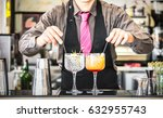 classic bartender serving gin... | Shutterstock . vector #632955743