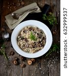 risotto with mushrooms on an... | Shutterstock . vector #632999537