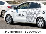 Small photo of MOSCOW, RUSSIA - CIRCA MAY, 2017: Modern city taxi cab car with Uber online internet taxi transportation service side markings on street at Moscow city center close up background