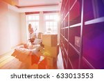 woman unpacking lamp from... | Shutterstock . vector #633013553
