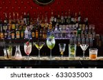 the visitors left empty glasses ... | Shutterstock . vector #633035003