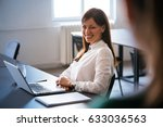 colleagues talking in office.... | Shutterstock . vector #633036563