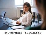 colleagues talking in office.... | Shutterstock . vector #633036563