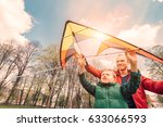 father and son start to fly a... | Shutterstock . vector #633066593