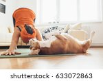 Stock photo i always will be near with you beagle dog lies on the yoga mat when his owner makes yoga exercises 633072863