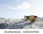 Sun Glasses Laying On A Rock B...