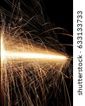 sparks while cutting steel | Shutterstock . vector #633133733
