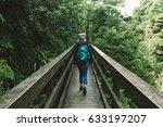 one woman walking on a bridge... | Shutterstock . vector #633197207