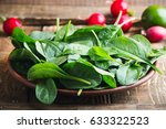 fresh baby spinach leaves in... | Shutterstock . vector #633322523